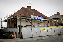 © Licensed to London News Pictures. 23/09/2013. Derby, UK. Pictured, Number 18, Victory Street, Derby, the house wher six children died in a house fire set by by their parents was starting to be demolished today. Photo credit : Dave Warren/LNP