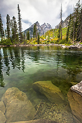 """The crystal clear water of Cottonwood Creek in Grand Teton National Park.  The Cathedral Group of the Grand Tetons towers above.<br /> <br /> For production prints or stock photos click the Purchase Print/License Photo Button in upper Right; for Fine Art """"Custom Prints"""" contact Daryl - 208-709-3250 or dh@greater-yellowstone.com"""