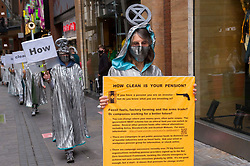 """© Licensed to London News Pictures;31/08/2020; Bristol, UK. Extinction Rebellion's 'Aged Agitators' stage a """"How clean is your pension"""" protest through Bristol's central shopping area against what they say are the negative effects of some pension investments. The protest is part of a bank holiday weekend of protest action titled """"Bristol Rebellion: We Want To Live"""". XR are protesting in Bristol and other cities in the UK against climate change, leading up to a protest in London starting on 01 September. XR say that despite clear scientific evidence of the deadly climate and ecological emergency, the UK government are refusing to take the urgent action needed to avoid mass extinction. XR say we need politicians to support the Climate and Ecological Emergency Bill. During the coronavirus covid-19 pandemic, climate change is being forgotten but it is still an emergency that is happening, the elephant in the room. Photo credit: Simon Chapman/LNP."""