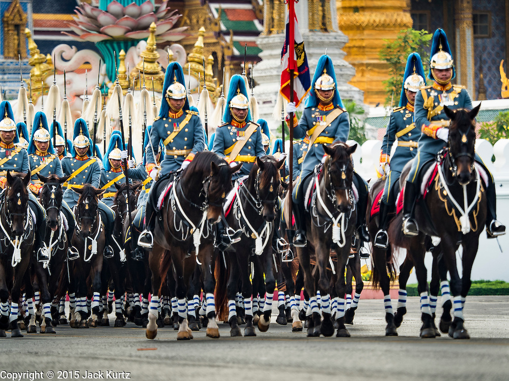 03 DECEMBER 2015 - BANGKOK, THAILAND:  A Thai army cavalry unit marches in the annual Trooping of the Colors parade to Sanam Luang in Bangkok. The Thai Royal Guards Parade, also known as Trooping of the Colors, occurs every December before the celebration of the birthday of Bhumibol Adulyadej, the King of Thailand. The Royal Guards of the Royal Thai Armed Forces perform a military parade and pledge loyalty to the monarch. Historically, the venue has been the Royal Plaza in front of the Dusit Palace and the Ananta Samakhom Throne Hall. This year it was held on Sanam Luang in front of the Grand Palace.   PHOTO BY JACK KURTZ