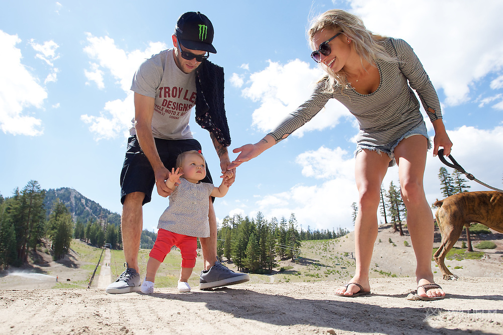 Cam Zink, fiancé Amanda, and baby Aeli (sp?) inspect the jump Day in the life of Cam Zink as he prepares for the Mammoth Backflip for World of X Games at Mammoth Mountain, CA. © Brett Wilhelm