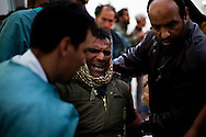 A severerly wounded man is helped into a hospital in Braga after a clash with forces loyal to Qadaffi on March 4, 2011.