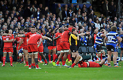 Toulouse celebrate as referee Nigel Owens blows for full time - Photo mandatory by-line: Patrick Khachfe/JMP - Mobile: 07966 386802 25/10/2014 - SPORT - RUGBY UNION - Bath - The Recreation Ground - Bath Rugby v Toulouse - European Rugby Champions Cup