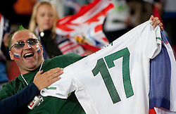 Fan of Slovenia celebrate with jersey of Andraz Kirm of Slovenia after the 2010 FIFA World Cup South Africa Group C match between Slovenia and USA at Ellis Park Stadium on June 18, 2010 in Johannesberg, South Africa. (Photo by Vid Ponikvar / Sportida)