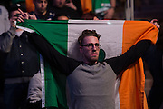 Fans cheer as Conor McGregor steps on the scale during the UFC 205 weigh-ins at Madison Square Garden in New York, New York on November 11, 2016.  (Cooper Neill for The Players Tribune)
