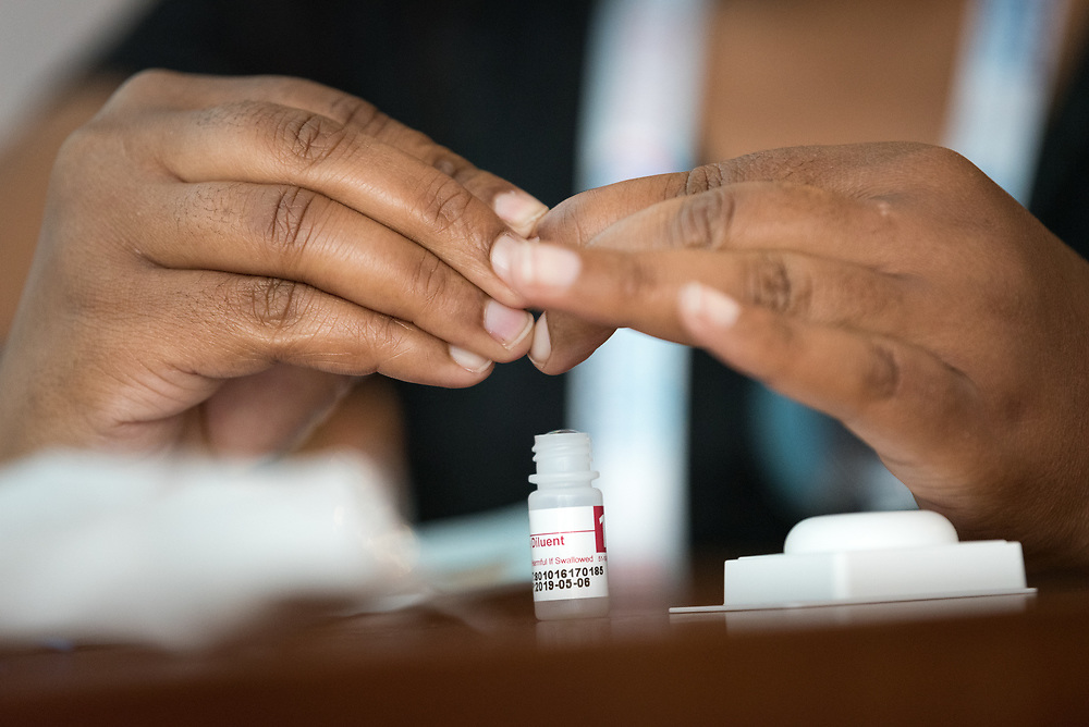 23 July 2018, Amsterdam, the Netherlands: Event promoting HIV self-testing, convened by the World Health Organization (WHO) and the World Council of Churches Ecumenical Advocacy Alliance, in connection with the 2018 International AIDS Conference. Here, Chengertai Chifamba from Zimbabwe demonstrates how to use a blood-sample based self-test. The 2018 International AIDS Conference, AIDS 2018, takes place in Amsterdam, the Netherlands on 23-27 July 2018. The event brings together people from around the globe, including a wide range of medical expertise, researchers, pharmaceuticals, governmental and non-governmental organizations, faith communities and faith-based organizations as well as other civil society stakeholders and individuals, for days of learning, sharing and interaction.