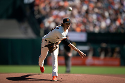 San Francisco Giants starting pitcher Kevin Gausman (34) delivers a pitch against the San Diego Padres during the first inning of a baseball game, Saturday, Oct. 2, 2021, in San Francisco. (AP Photo/D. Ross Cameron)