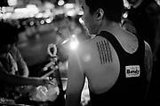Bangkok February 2010, Man showing Sak Yant tattoos on his back.