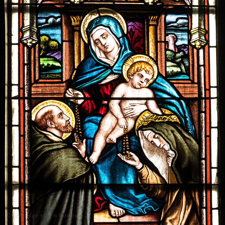 Window 2 on plan. <br /> Also known as 'Virign and Child presenting the Rosary to St. Dominic and St. Catherine of Sienna.' Based on a painting by Giovanni Battista Salvi (1609-1685) in the Chapel of Saint Catherine of Sienna at Santa Sabina, Rome.<br /> <br /> Holy Redeemer Catholic Church, Bar Harbor, Maine.