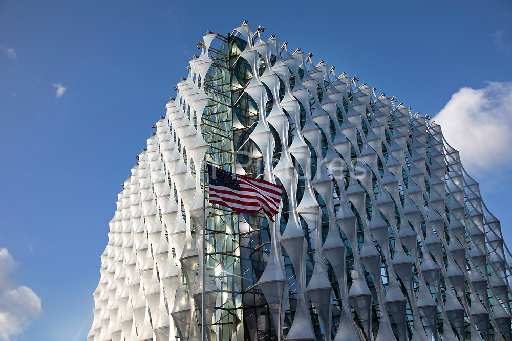 Exterior of the new US Embassy building with the Stars and Stripes flag in the Nine Elms area of Wandsworth, London, England, United Kingdom. The Embassy of the United States of America in London is the diplomatic mission of the United States in the United Kingdom. It is the largest American embassy in Western Europe and the focal point for events relating to the United States held in the United Kingdom.