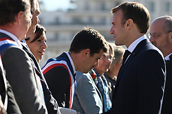 Paris Mayor Abbe Hidalgo greets President Emmanuel Macron as he arrives for a visit to the construction site of the 2024 Olympic Games Village in Saint-Ouen on the outskirts of Paris, France on October 14, 2021, part of a visit to construction sites dedicated to the Paris 2024 Olympic and Paralympic Games. Photo by Eliot Blondet/ABACAPRESS.COM