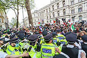 London, United Kingdom, May 11, 2021: Police mounted a cordon to pull out pro-Israeli protestors waving Israeli flags who gathered in Richmond Terrace outside Downing Street to counter the Pro-Palestinian demonstrators on Tuesday, May 11, 2021. (Photo by Vudi Xhymshiti/VXP)