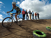 PRICE CHAMBERS / NEWS&GUIDE<br /> Sam Krieg speeds by spectators at the 2011 Moose Cross in Victor's Pioneer Park on Sunday, rounding out a weekend of racing through the dirt trails as he takes third place in the Men's 1-2-3 category.