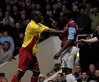 Photo: Olly Greenwood.<br />West Ham United v Watford. The Barclays Premiership. 10/02/2007. Watford's Moses Ashikodi confronts West Ham's Nigel Reo-Coker