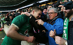 Ireland's Johnny Sexton celebrates with fans after winning the Grand Slam during the NatWest 6 Nations match at Twickenham Stadium, London.