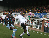 Photo: Mark Stephenson/Richard Lane Photography. <br /> Hereford United v Bury. Coca-Cola League Two. 21/03/2008. Hereford's Theo Robinson holds the ball up from Bury's Efe Sodje
