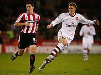 Photo: Steve Bond.<br />Sheffield United v Arsenal. Carling Cup. 31/10/2007. Nicklas Bendtner (R) shoots as Chris Morgan (L) tries to get close