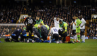 Owen Coyle Manager and Tottenham Hotspur watch as player Fabrice Muamba is given emergency CPR by Paramedics on the pitch after collapsing Bolton Wanderers 2011/12<br />The Match was later Abandoned<br />Tottenham Hotspur V Bolton Wanderers (1-1) 17/03/12<br />The FA Cup 6th Round<br />Photo: Robin Parker Fotosports International
