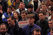 The Socialist Militant newspaper is held by a man alongside other workers, listen to speeches in central Liverpool during the bin men strike of 1991, on 14th June 1991, in Liverpool, England. The industrial action against the local authority was a health problem for Liverpool over that summer when streets filled with rubbish. Vermin such as rats ran around and public city parks filled with every kind of refuse and garbage.