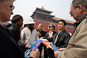 Tourists from the United States visit the Forbidden City in Beijing.
