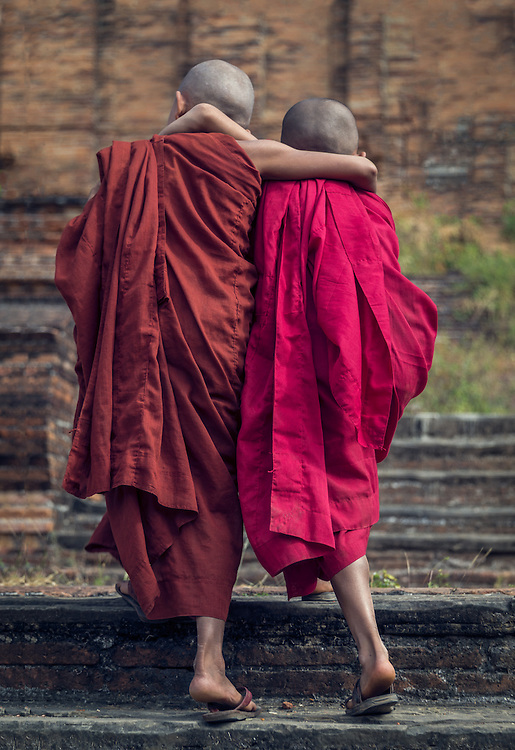 MANDALAY, MYANMAR - CIRCA DECEMBER 2013: Novice monks walking away in Min Kun in Myanmar