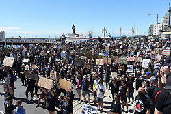 © Licensed to London News Pictures. 13/06/2020. Brighton, UK. Huge crowds gather for a Black Lives Matter demo on Brighton seafront in East Sussex.  Photo credit: Liz Pearce/LNP