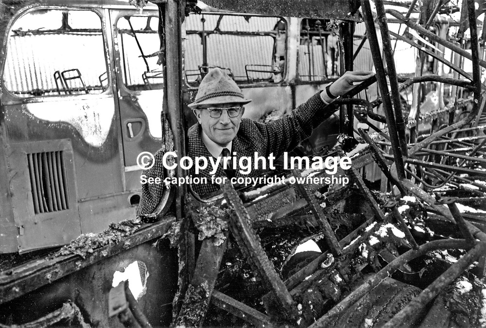 Mr Werner Heubeck, director, Ulsterbus and Citybus, among the wreckage of burnt-out buses at the company's Falls Road Depot, Belfast, N Ireland. Ref: 197701001.<br /> <br /> Copyright Image from Victor Patterson, Belfast, UK<br /> <br /> t: +44 28 9066 1296 (from Rep of Ireland 048 9066 1296)<br /> m: +44 7802 353836<br /> e: victorpattersonbelfast@gmail.com<br /> <br /> www.images4media.com<br /> <br /> Please see my full Terms and Conditions of Use at https://www.images4media.com/p/terms-conditions - it is IMPORTANT that you familiarise yourself with them.<br /> <br /> Images used online incur an additional cost. This cost should be agreed in writing in advance. Online images must be visibly watermarked i.e. © Victor Patterson or that of the named photographer within the body of the image. The original metadata must not be deleted from images used online.<br /> <br /> This image is only available for the use of the download recipient i.e. television station, newspaper, magazine, book publisher, etc, and must not be passed on to a third party. It is also downloaded on condition that each and every usage is notified within 7 days to victorpattersonbelfast@gmail.com.<br /> <br /> The right of Victor Patterson (or the named photographer) to be identified as the author is asserted in accordance with The Copyright Designs And Patents Act (1988). All moral rights are asserted.