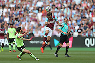 Mark Noble, West Ham United captain heads the ball clear. Premier league match, West Ham Utd v AFC Bournemouth at the London Stadium, Queen Elizabeth Olympic Park in London on Sunday 21st August 2016.<br /> pic by John Patrick Fletcher, Andrew Orchard sports photography.