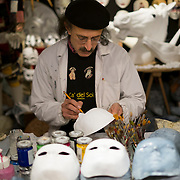 An artisan at Ca del Sol works on a mask, Artisans, masks and costumes makers are getting ready ahead of Venice Carnival 2013