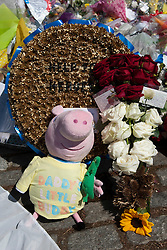 © London News Pictures. 26/05/2013. Woolwich, UK. Flowers and a pepper pig toy  left by Rebecca Rigby, wife of Drummer Lee Rigby outside Woolwich Barracks near where he was murdered by two men in Woolwich town centre in what is being described as a terrorist attack. Photo credit: Ben Cawthra/LNP