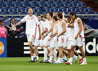 Photo: Chris Ratcliffe.<br />England Training Session. FIFA World Cup 2006. 30/06/2006.<br />Peter Crouch shares a joke in training.