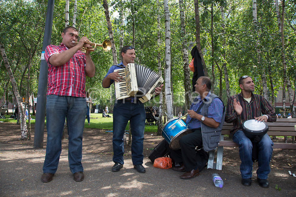 Romanian buskers perform at Bankside in London. This troupe of trumpet blowing, accordian playing and drumming immigrants to the UK have become famous along the South Bank area performing their energetic music to thousands.