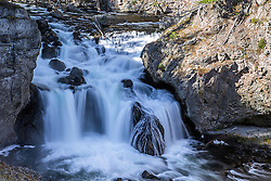 Firehole Falls in Yellowstone National Park.  Firehole Falls is a 40 foot waterfall amidst 800-foot thick lava flows forming the canyon walls.