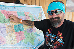 Placing a pin for your hometown on the map at the Buffalo Chip on the final Saturday of the annual Sturgis Black Hills Motorcycle Rally. SD, USA. August 13, 2016. Photography ©2016 Michael Lichter.