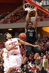 18 March 2015:  Greg Mays completes a dunk as Reggie Lynch tries to get out of the way  during an NIT men's basketball game between the Green Bay Phoenix and the Illinois State Redbirds at Redbird Arena in Normal Illinois