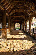 Old stone flagstones and timber beams, joists, rafters and purlins of the 17th Century Market Hall in Chipping Campden in The Cotswolds, Oxfordshire, UK