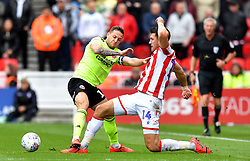 Sheffield United's Billy Sharp (left) and Stoke City's Danny Batth (right) battle for the ball during the Sky Bet Championship match at the bet365 Stadium, Stoke.