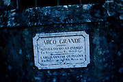 """Plaque that marks the Arco Grande in the Aguas Livres aqueduct. Since its foundation, the city of Lisbon had problems with the supply of drinking water to the population. In order to solve this problem, in 1731 King John V begins the contruction of the long-touted """"Aguas Livres Aqueduct"""" wich has its construction completed in 1748, from this moment Lisbon would have 3 times more water than previously available.<br /> The aqueduct extends over 14,174 meters and consists of 127 arches along its route. Of all the arches, the most known is the one in the valley of Alcantara, the Arco Grande, is 65 meters high and is the largest pointed arch in the world.<br /> The other reason that made the Aqueduct famous is to have been the stage of nineteenth century's most famous serial killer in Portugal, Diogo Alves. Born in Spain, came to live in Lisbon at a very early age, known as the """"Assassino do Aqueduto das Aguas Livres"""" or also """"Pancadas"""". Diogo Alves is thought to have robbed and thrown from the Arco Grande area more than seventy people. No one ever found out how he got the key to enter the aqueduct and commit the crimes.<br /> Diogo Alves was convicted and hanged in 1841. His head was stored in formalin at the time so that medicine could studie his and be able to characterize the mind of a criminal.<br /> In 1911 is presented to the public the film """"Os crimes de Diogo Alves,"""" the first Portuguese fictional film. 15/01/2012 NO SALES IN PORTUGAL"""