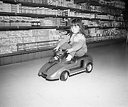 Electric Car Race at Supermarkets.<br /> 1971.<br /> 30.10.1971.<br /> 10.30.1971.<br /> 30th October 1971.<br /> Elect car races were held in Powers Supermarkets in Stillorgan,Blackrock Co Dublin and in Bray Co Wicklow.<br /> <br /> Picture shows four year old Celine Cahill of Ranelagh ,Dublin during her run in the electric car.