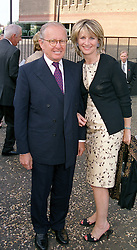 Art patrons MR GILBERT and the HON.MRS DE BOTTON,<br />  at a party in London on 11th May 2000.OSY 21