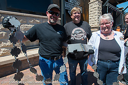 Harley-Davidson's Bill Davidson with Sturgis, SD Mayor Mark Carstensen and Sturgis Motorcycle Museum director Christine Paige Diers at the official chain torching ceremony for the brand new Harley-Davidson Rally Point on the corner of Main Street and Harley Way during the 75th Annual Sturgis Black Hills Motorcycle Rally.  SD, USA.  July 31, 2015.  Photography ©2015 Michael Lichter.