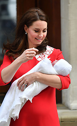 Duchess of Cambridge holds her newborn son outside the Lindo Wing at St Mary's Hospital in Paddington, London.