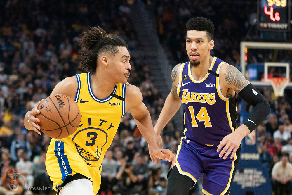 February 27, 2020; San Francisco, California, USA; Golden State Warriors guard Jordan Poole (3) dribbles the basketball against Los Angeles Lakers guard Danny Green (14) during the third quarter at Chase Center.