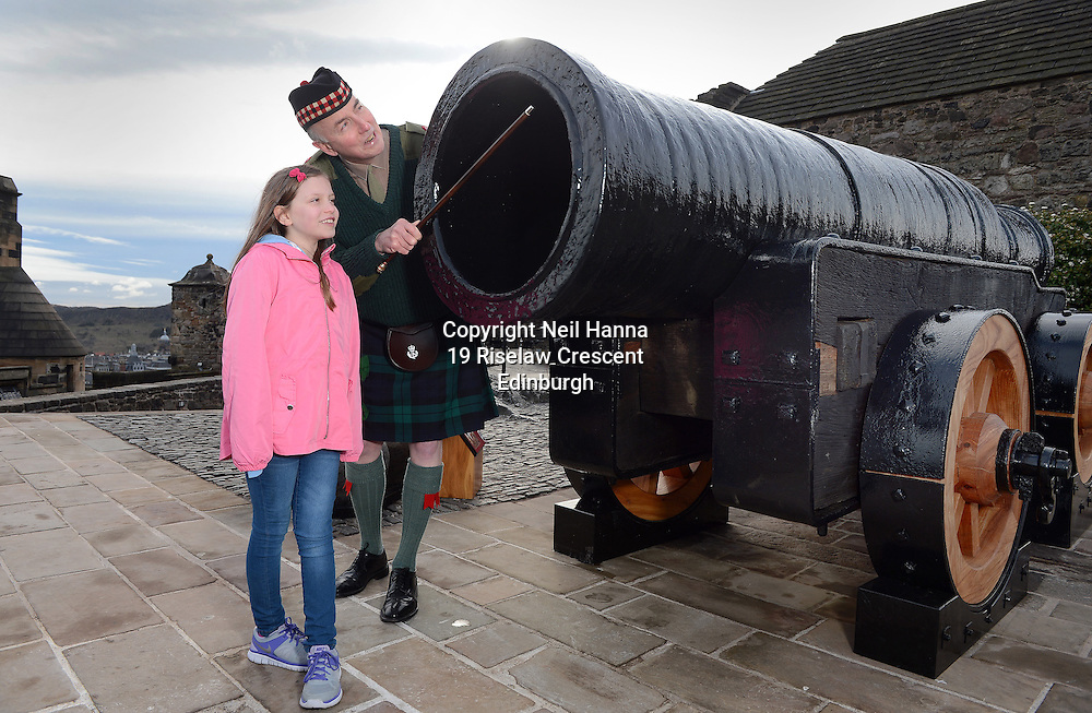 Edinburgh Castle Monday 23/05/2015<br /> <br /> MONS MEG RETURNS TO EDINBURGH CASTLE FOLLOWING MOT<br />  <br /> Mons Meg, the world's most famous medieval gun, was welcomed back to Edinburgh Castle this morning (23/03/15). The six tonne cannon has been undergoing specialist conservation work over the past two months at a secret location – the first time it has left the castle in over 30 years. Amongst the first visitors to inspect the works were Beth Graham, 9 from East Kilbride and Major Niall Archibald of The Royal Regiment of Scotland.<br /> <br />  Neil Hanna Photography<br /> www.neilhannaphotography.co.uk<br /> 07702 246823