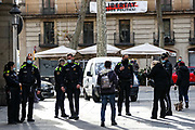 Police in Barcelona appears to be asking members of the public to wear their face surgical mask on Sunday, Dec 6, 2020. Spain's northeastern Catalonia region is easing restrictions, with bars, cafes, restaurants and gyms reopening in Barcelona. Nightlife is still banned because of a curfew from 10pm, which also applies throughout Spain. Catalonia's eating places can only accept 30% of their normal clientele indoors. Cinemas and concert halls are also reopening, but they can only operate half-full. (VXP Photo/ Vudi Xhymshiti)