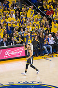 Golden State Warriors guard Stephen Curry (30) celebrates a made three pointer against the New Orleans Pelicans at Oracle Arena during Game 2 of the Western Semifinals in Oakland, California, on May 1, 2018. (Stan Olszewski/Special to S.F. Examiner)