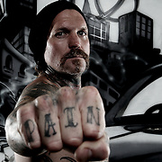 GOLD COAST, AUSTRALIA - JULY 12:  American Motorcyclist Seth Enslow poses for a portrait session outside Aces Wild Tattoo Studio on July 12, 2011 in Gold Coast, Australia.  (Photo by Chris Hyde/Getty Images) *** Local Caption *** Seth Enslow