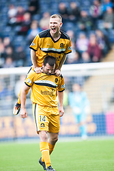 Dumbarton's Garry Fleming (bottom) celebrates after scoring their first goal.<br /> Falkirk 1 v 2 Dumbarton, Scottish Championship game played today at the Falkirk Stadium.<br /> ©Michael Schofield.