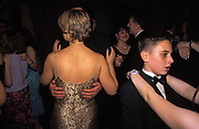 13 year-old Adam leader dances with a girl at his Bar Mitzvah, a lavish party in Borehamwood, on 14th October 2001, in north London, England. Paid for by his parents, the celebration took place in a hotel off the A1 road and Adam can be seen with the arms of a young lady while a pair of hands reach around the back of his mother (left).