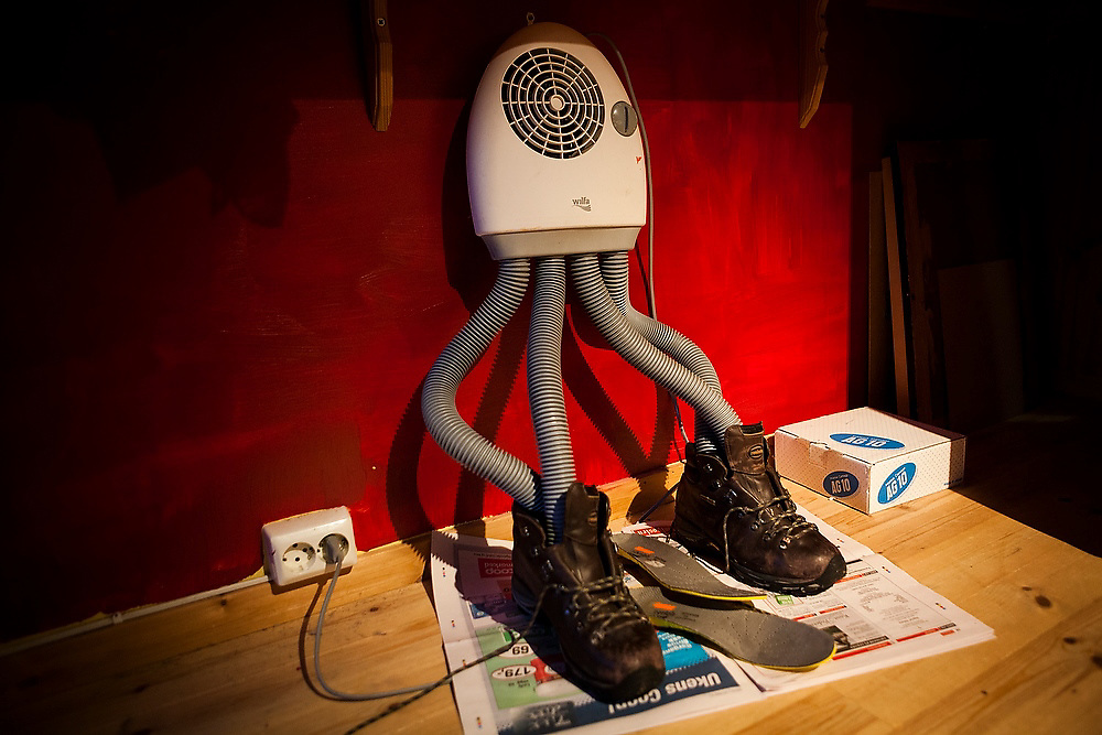 Leather hiking boots are dried with a boot dryer at a home in Sorland, Vaeroy Island, Lofoten Islands, Norway.